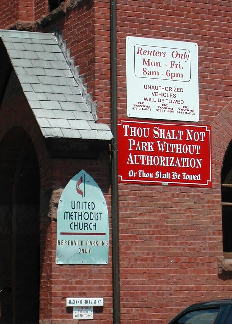 Thou shalt not park without authorization, or thou shalt be towed.